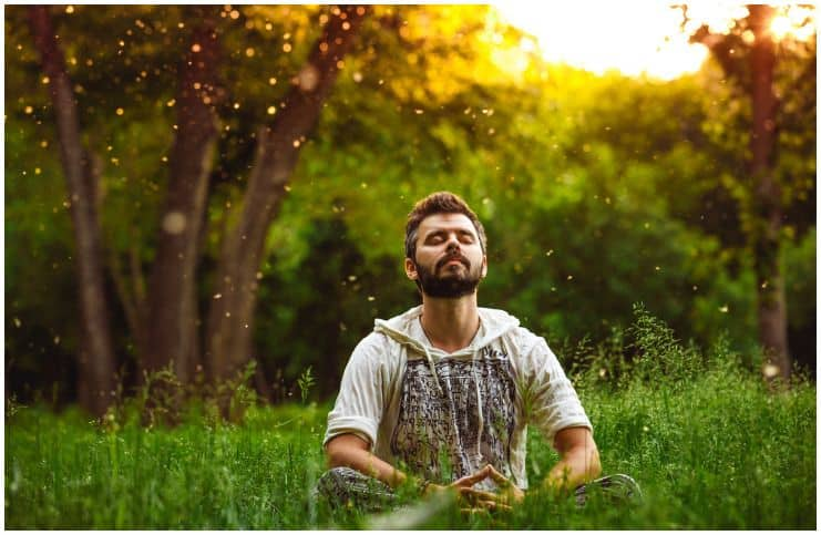 man practicing a meditation in nature