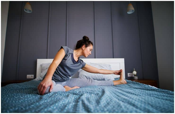 woman doing yoga before sleep