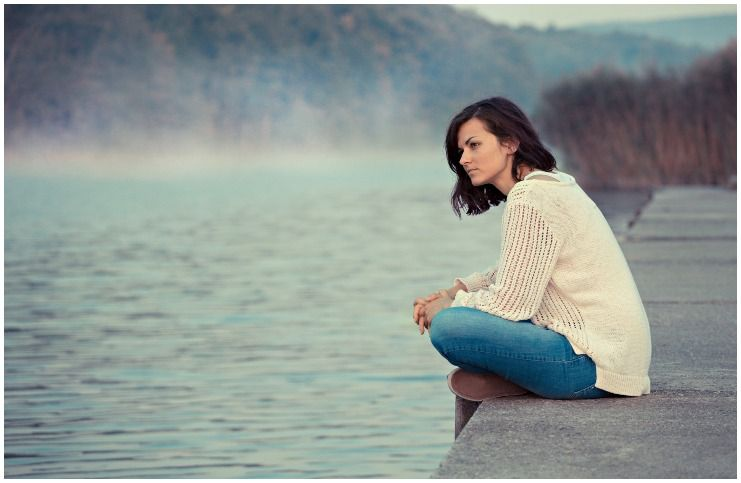 woman in nature lake