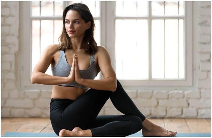 woman doing yoga on the floor