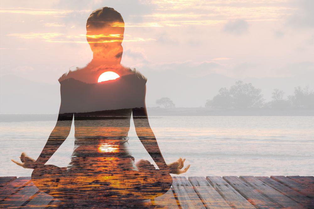 woman in a meditation sunrise