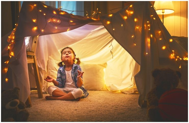 child meditation in a tent